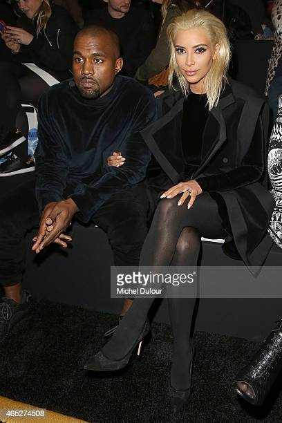 Kanye West and Kim Kardashian attend the Balmain show as part of the Paris Fashion Week Womenswear Fall/Winter 2015/2016 on March 5 2015 in Paris...