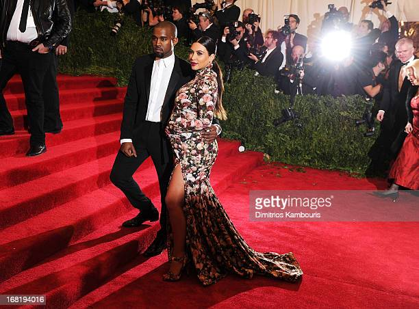 Kanye West and Kim Kardashian attend the Costume Institute Gala for the 'PUNK Chaos to Couture' exhibition at the Metropolitan Museum of Art on May 6...