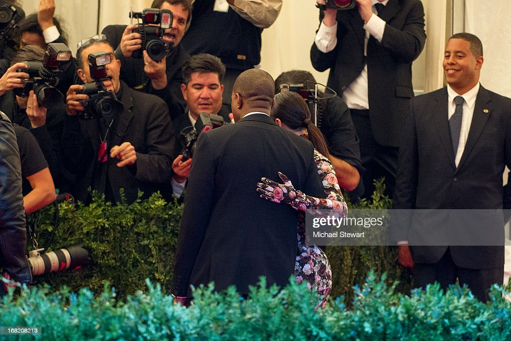 Kanye West (L) and Kim Kardashian attend the Costume Institute Gala for the 'PUNK: Chaos to Couture' exhibition at the Metropolitan Museum of Art on May 6, 2013 in New York City.