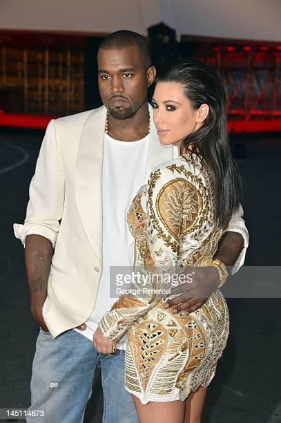 Kanye West and Kim Kardashian attend the 'Cruel Summer' Premiere during the 65th Annual Cannes Film Festival at Palm Beach on May 23 2012 in Cannes...