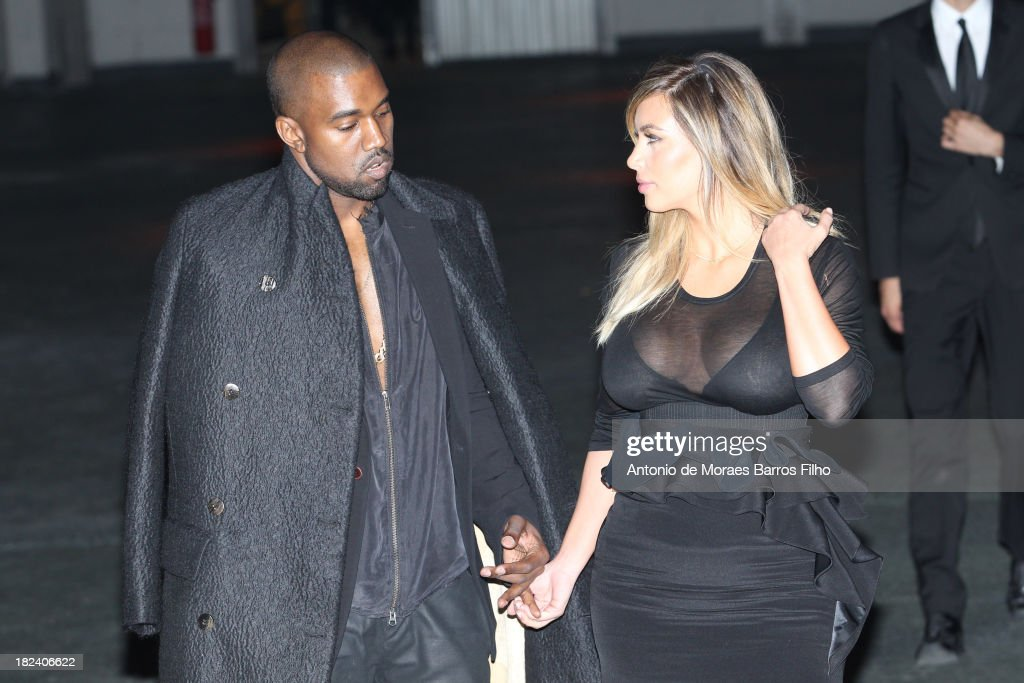 Kanye West and Kim Kardashian attend the Givenchy show as part of the Paris Fashion Week Womenswear Spring/Summer 2014 on September 29, 2013 in Paris, France.