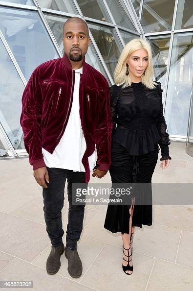 Kanye West and Kim Kardashian attend the Louis Vuitton show as part of the Paris Fashion Week Womenswear Fall/Winter 2015/2016 on March 11 2015 in...