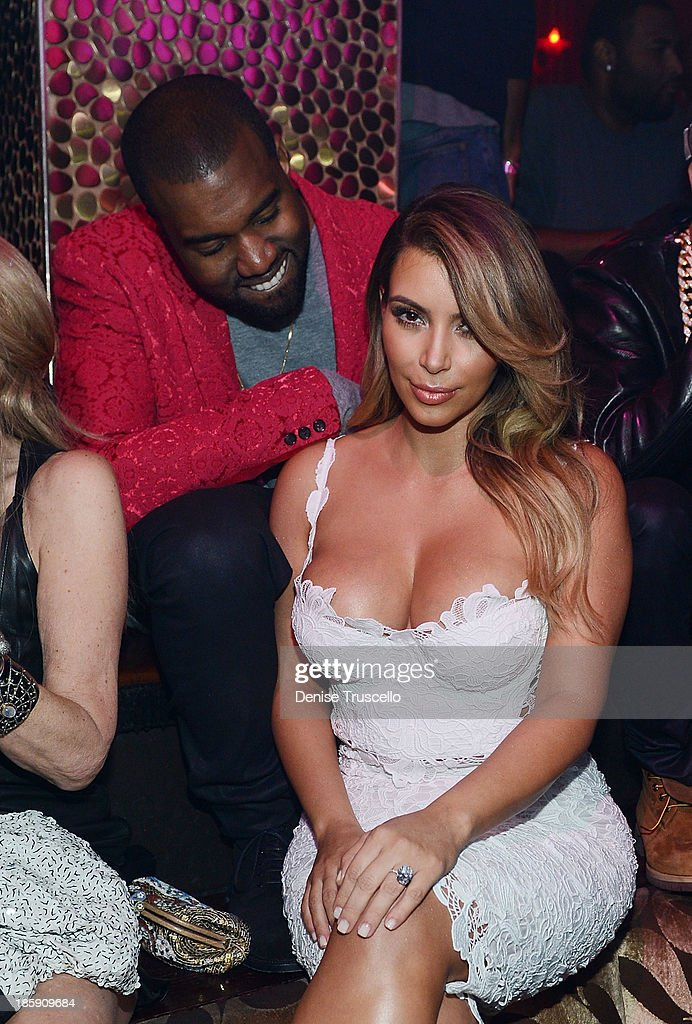 <a gi-track='captionPersonalityLinkClicked' href=/galleries/search?phrase=Kanye+West+-+Musician&family=editorial&specificpeople=201803 ng-click='$event.stopPropagation()'>Kanye West</a> and <a gi-track='captionPersonalityLinkClicked' href=/galleries/search?phrase=Kim+Kardashian&family=editorial&specificpeople=753387 ng-click='$event.stopPropagation()'>Kim Kardashian</a> celebrate <a gi-track='captionPersonalityLinkClicked' href=/galleries/search?phrase=Kim+Kardashian&family=editorial&specificpeople=753387 ng-click='$event.stopPropagation()'>Kim Kardashian</a>'s 33rd birthday at Tao Las Vegas on October 25, 2013 in Las Vegas, Nevada.