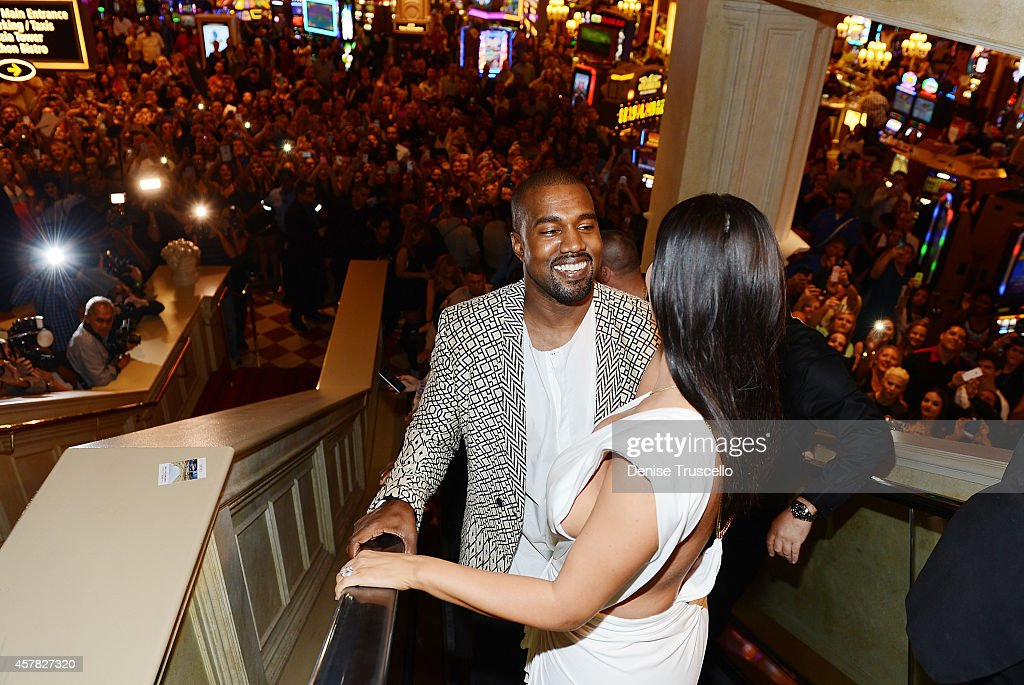 Kanye West and Kim Kardashian West arrive at TAO Nightclub to celebrate her birthday at the Venetian on October 24 2014 in Las Vegas Nevada