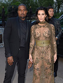 Kanye West and Kim Kardashian West arrive for the Gala to celebrate the Vogue 100 Festival at Kensington Gardens on May 23 2016 in London England