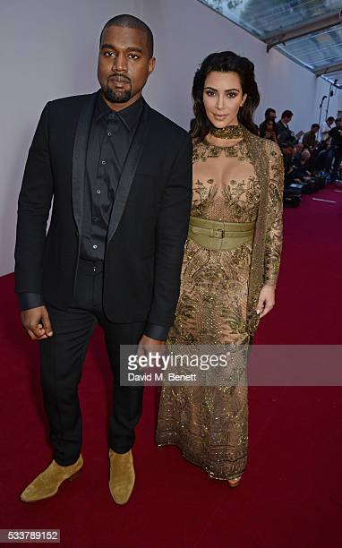 Kanye West and Kim Kardashian West attend British Vogue's Centenary gala dinner at Kensington Gardens on May 23 2016 in London England