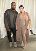 Kanye West and Kim Kardashian West attend Kanye West Yeezy Season 2 during New York Fashion Week at Skylight Modern on September 16 2015 in New York...