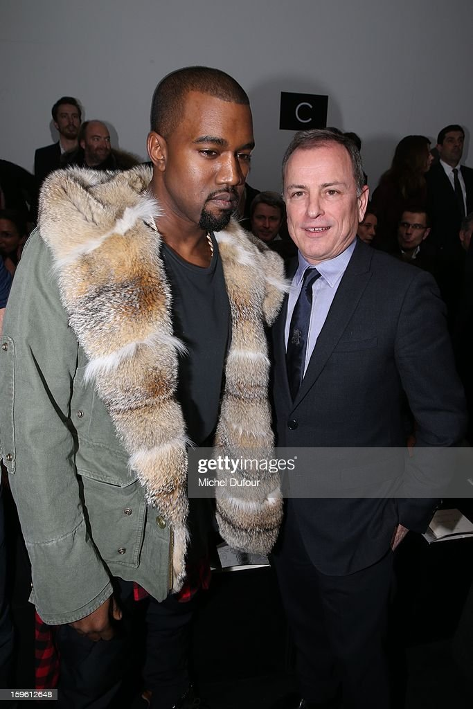 Kanye West and Michael Burke attend the Louis Vuitton Men Autumn / Winter 2013 show as part of Paris Fashion Week on January 17, 2013 in Paris, France.