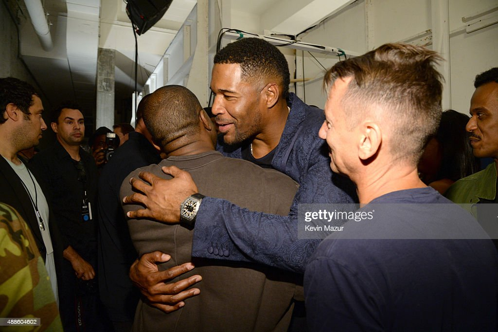 Kanye West and Michael Strahan attend Kanye West Yeezy Season 2 during New York Fashion Week at Skylight Modern on September 16, 2015 in New York City.