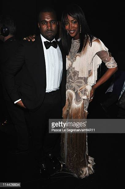Kanye West and Naomi Campbell attend amfAR's Cinema Against AIDS Gala during the 64th Annual Cannes Film Festival at Hotel Du Cap on May 19 2011 in...
