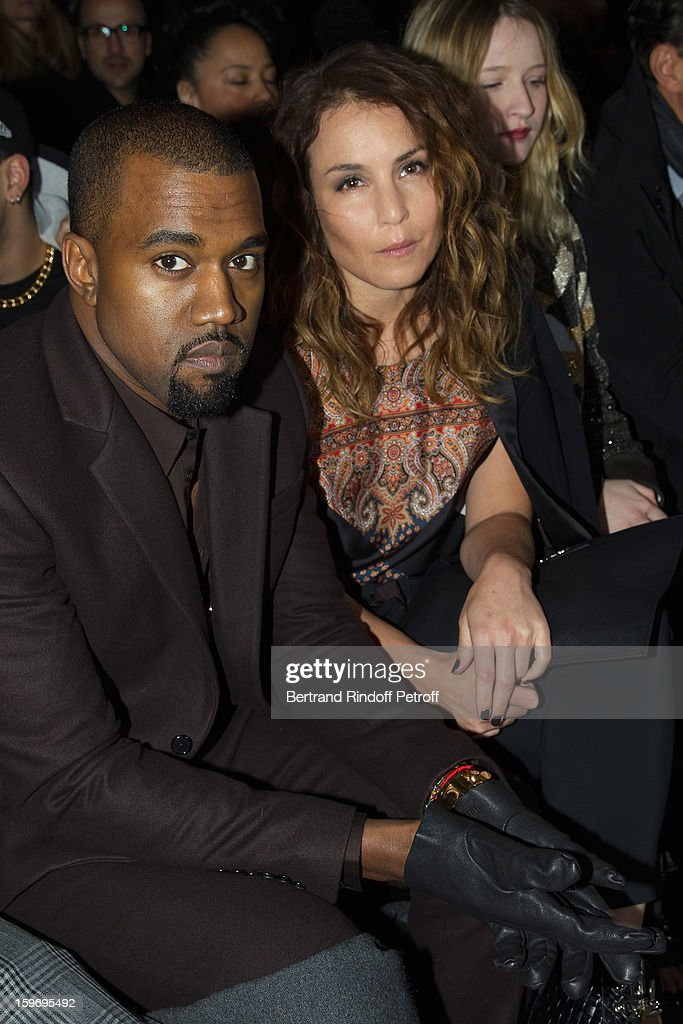 <a gi-track='captionPersonalityLinkClicked' href=/galleries/search?phrase=Kanye+West+-+Musicista&family=editorial&specificpeople=201803 ng-click='$event.stopPropagation()'>Kanye West</a> (L) and <a gi-track='captionPersonalityLinkClicked' href=/galleries/search?phrase=Noomi+Rapace&family=editorial&specificpeople=4522889 ng-click='$event.stopPropagation()'>Noomi Rapace</a> attend the Givenchy Men Autumn / Winter 2013 show as part of Paris Fashion Week on January 18, 2013 in Paris, France.