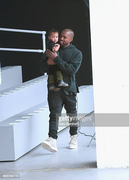Kanye West and North West attend the adidas show during MercedesBenz Fashion Week Fall 2015 at Skylight Clarkson SQ on February 12 2015 in New York...