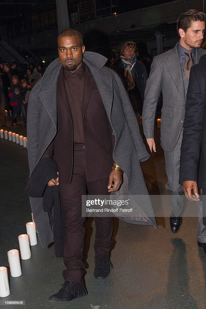 <a gi-track='captionPersonalityLinkClicked' href=/galleries/search?phrase=Kanye+West+-+Muzikant&family=editorial&specificpeople=201803 ng-click='$event.stopPropagation()'>Kanye West</a> (L) and <a gi-track='captionPersonalityLinkClicked' href=/galleries/search?phrase=Scott+Disick&family=editorial&specificpeople=4420046 ng-click='$event.stopPropagation()'>Scott Disick</a> (R) attend the Givenchy Men Autumn / Winter 2013 show as part of Paris Fashion Week on January 18, 2013 in Paris, France.
