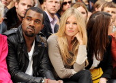 Kanye West and Sienna Miller attend at the Burberry Spring Summer 2012 Womenswear Show at Kensington Gardens on September 19 2011 in London England