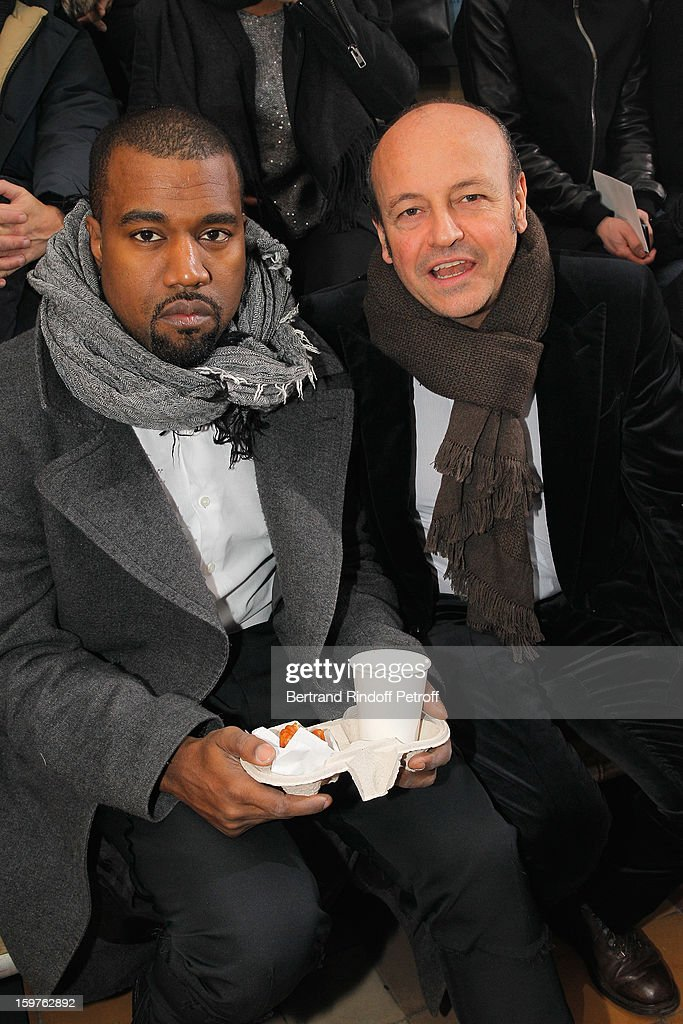 Kanye West (L) and Thierry Andretta, CEO of Lanvin, attend the Lanvin Men Autumn / Winter 2013 show at Ecole Nationale Superieure Des Beaux-Arts as part of Paris Fashion Week on January 20, 2013 in Paris, France.