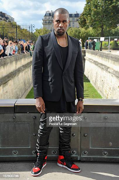 Kanye West arrives at the Christian Dior Spring / Summer 2013 show as part of Paris Fashion Week on September 28 2012 in Paris France