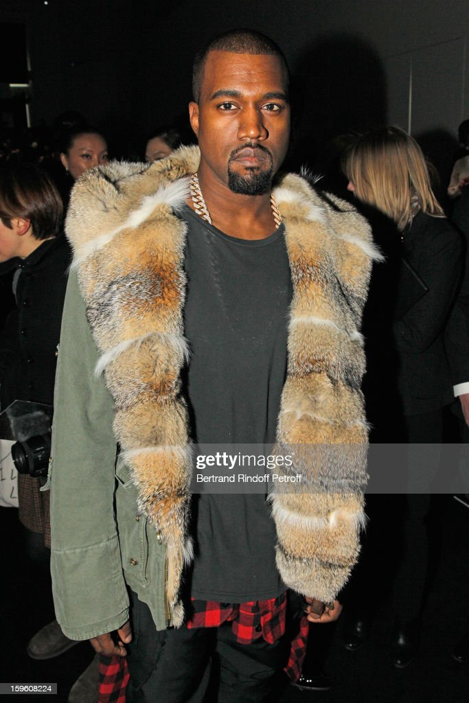 <a gi-track='captionPersonalityLinkClicked' href=/galleries/search?phrase=Kanye+West+-+Musician&family=editorial&specificpeople=201803 ng-click='$event.stopPropagation()'>Kanye West</a> attends the Louis Vuitton Men Autumn / Winter 2013 show as part of Paris Fashion Week on January 17, 2013 in Paris, France.
