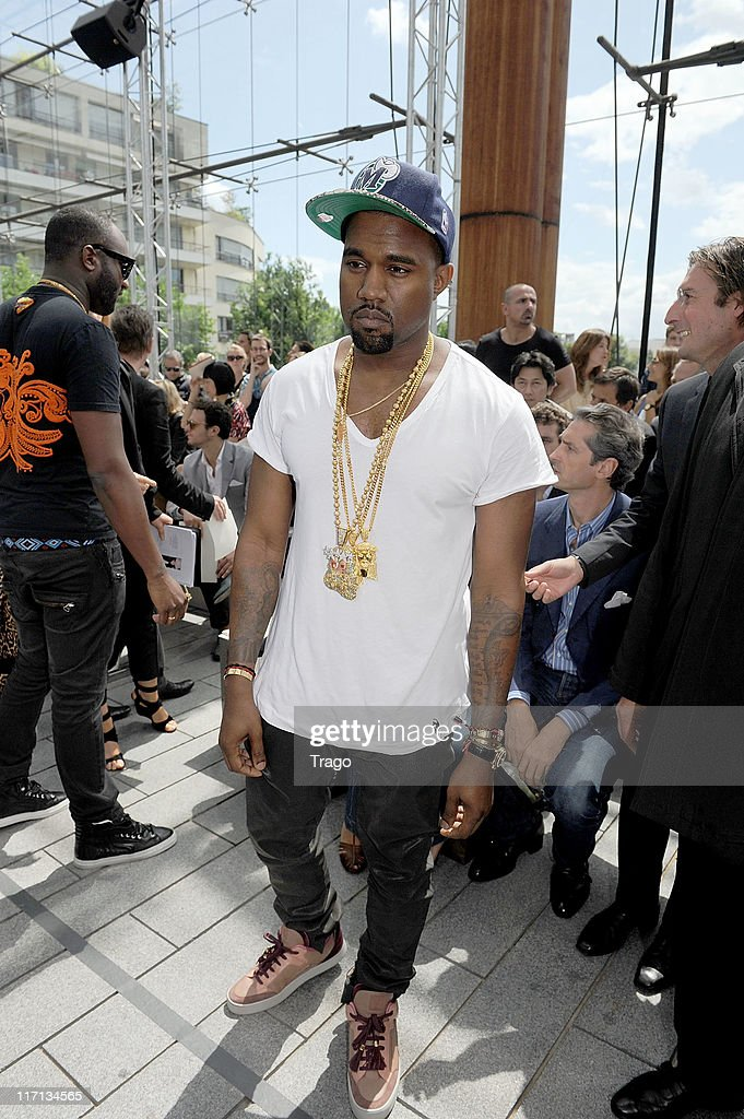 <a gi-track='captionPersonalityLinkClicked' href=/galleries/search?phrase=Kanye+West+-+Musician&family=editorial&specificpeople=201803 ng-click='$event.stopPropagation()'>Kanye West</a> attends the Louis Vuitton Menswear Spring/Summer 2012 show as part of Paris Fashion Week at Parc Andre Citroen on June 23, 2011 in Paris, France.