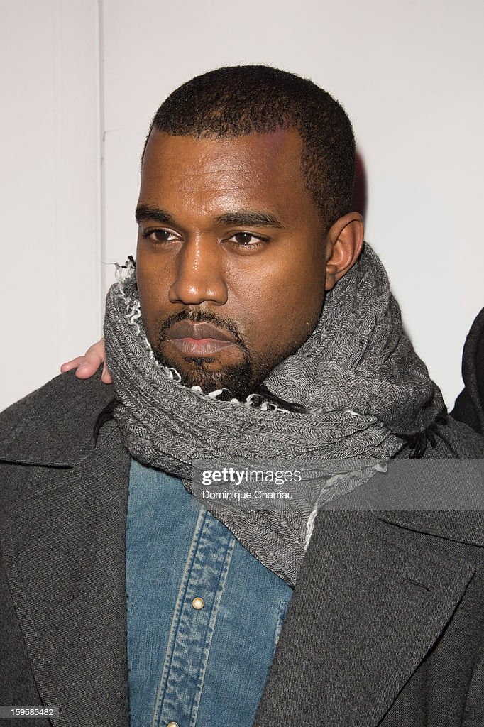 <a gi-track='captionPersonalityLinkClicked' href=/galleries/search?phrase=Kanye+West+-+M%C3%BAsico&family=editorial&specificpeople=201803 ng-click='$event.stopPropagation()'>Kanye West</a> attends the Raf Simons Men Autumn / Winter 2013 show as part of Paris Fashion Week on January 16, 2013 in Paris, France.