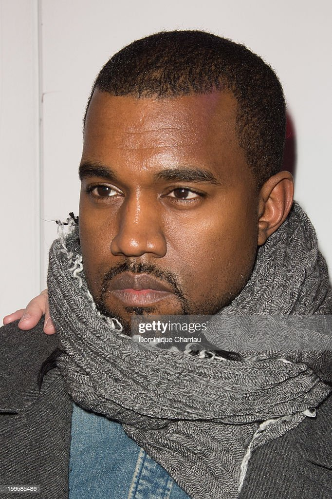 <a gi-track='captionPersonalityLinkClicked' href=/galleries/search?phrase=Kanye+West+-+Musician&family=editorial&specificpeople=201803 ng-click='$event.stopPropagation()'>Kanye West</a> attends the Raf Simons Men Autumn / Winter 2013 show as part of Paris Fashion Week on January 16, 2013 in Paris, France.