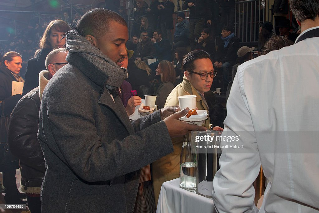 Kanye West helps himself with hot drink and cake prior to attending the Lanvin Men Autumn / Winter 2013 show at Ecole Nationale Superieure Des Beaux-Arts as part of Paris Fashion Week on January 20, 2013 in Paris, France.