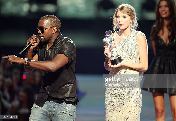 Kanye West jumps onstage after Taylor Swift won the 'Best Female Video' award during the 2009 MTV Video Music Awards at Radio City Music Hall on...
