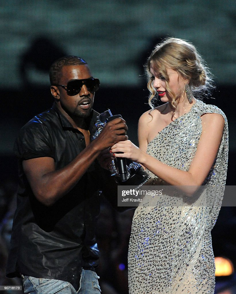 Kanye West (L) jumps onstage as Taylor Swift accepts her award for the 'Best Female Video' award during the 2009 MTV Video Music Awards at Radio City Music Hall on September 13, 2009 in New York City.