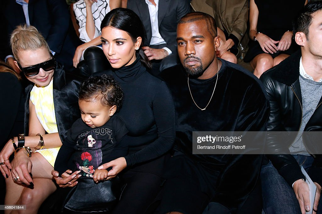 Kanye West, Kim Kardashian and their daughter North West attend the Balenciaga show as part of the Paris Fashion Week Womenswear Spring/Summer 2015 on September 24, 2014 in Paris, France.
