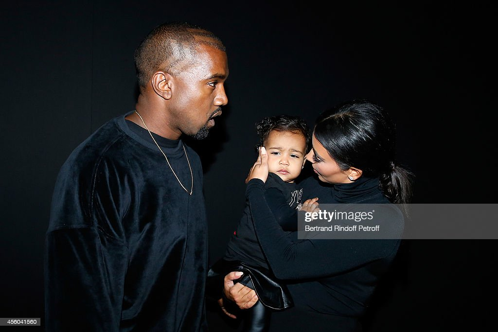 Kanye West, Kim Kardashian and theis daughter North West attend the Balenciaga show as part of the Paris Fashion Week Womenswear Spring/Summer 2015 on September 24, 2014 in Paris, France.