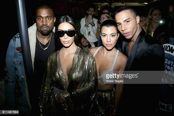 Kanye West Kim Kardashian West Kourtney Kardashian and Olivier Rousteing attend the Balmain aftershow party as part of the Paris Fashion Week...