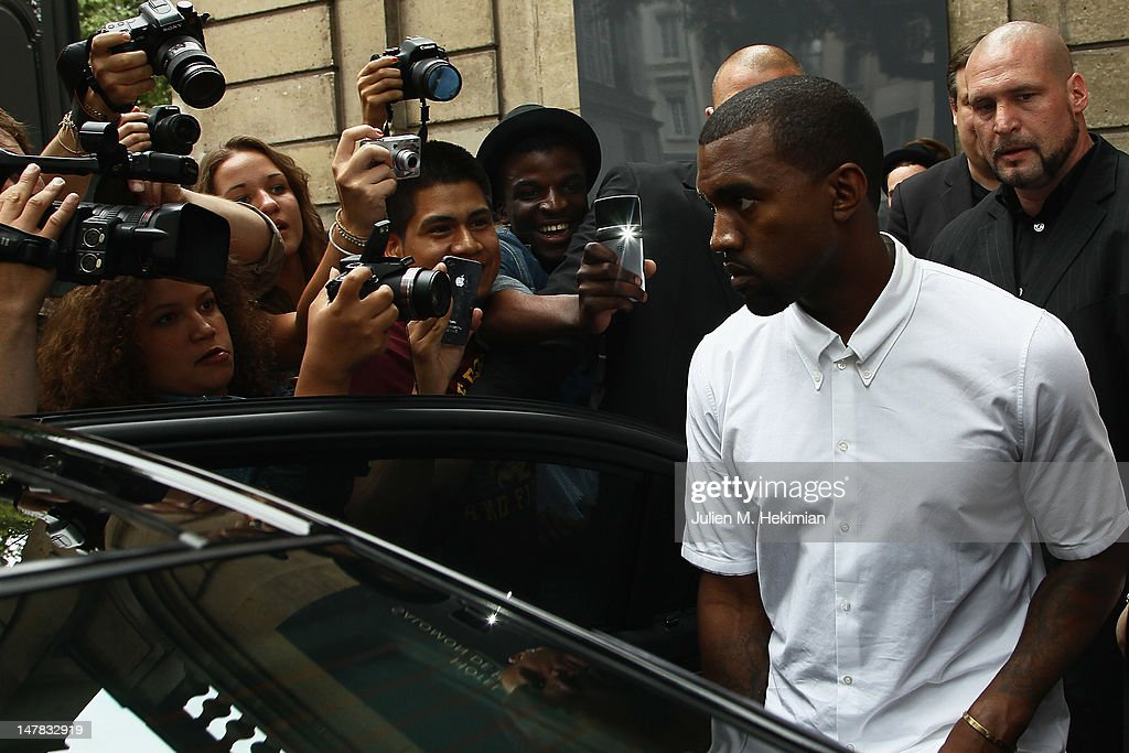 <a gi-track='captionPersonalityLinkClicked' href=/galleries/search?phrase=Kanye+West+-+Musician&family=editorial&specificpeople=201803 ng-click='$event.stopPropagation()'>Kanye West</a> leaves the Valentino Haute-Couture Show as part of Paris Fashion Week Fall / Winter 2012/2013 at Hotel Salomon de Rothschild on July 4, 2012 in Paris, France.