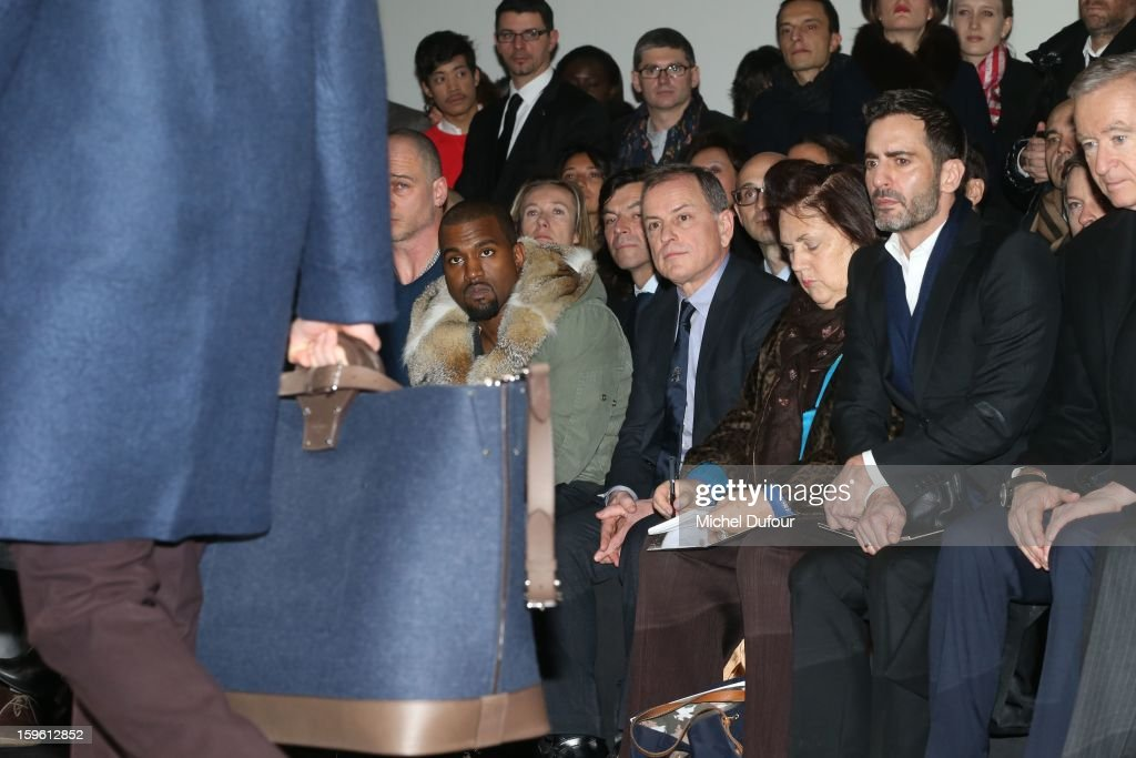 Kanye West, Michael Burke, Suzy Menkes and Marc Jacobs attend the Louis Vuitton Men Autumn / Winter 2013 show as part of Paris Fashion Week on January 17, 2013 in Paris, France.