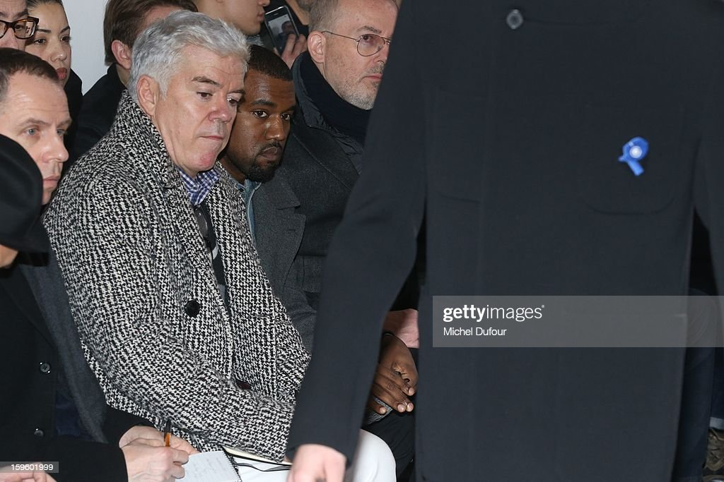 Kanye West (C) sits in front row at the Raf Simons Men Autumn / Winter 2013 show as part of Paris Fashion Week on January 16, 2013 in Paris, France.