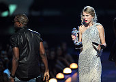 Kanye West takes the microphone from Taylor Swift and speaks onstage during the 2009 MTV Video Music Awards at Radio City Music Hall on September 13...