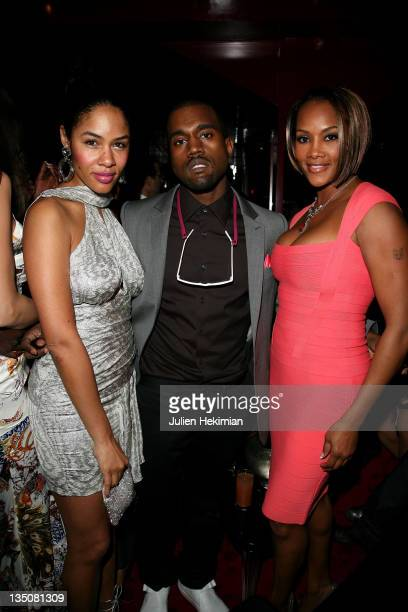 Kanye West with his wife and Vivica Fox attend the Cavalli Party at Crazy Horse on February 26 2008 in Paris France