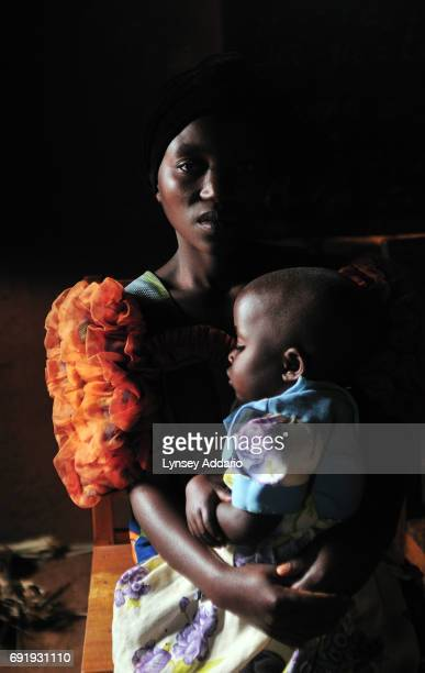 Kanyere holds her three year old child Kabira in the village of Kanyabayonga in a shelter in North Kivu in Eastern Congo April 12 2008 Kabira was...