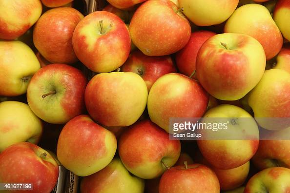 Kanzi apples from Germany lie on display at a stand at the International Green Week agricultural trade fair on January 16 2015 in Berlin Germany The...
