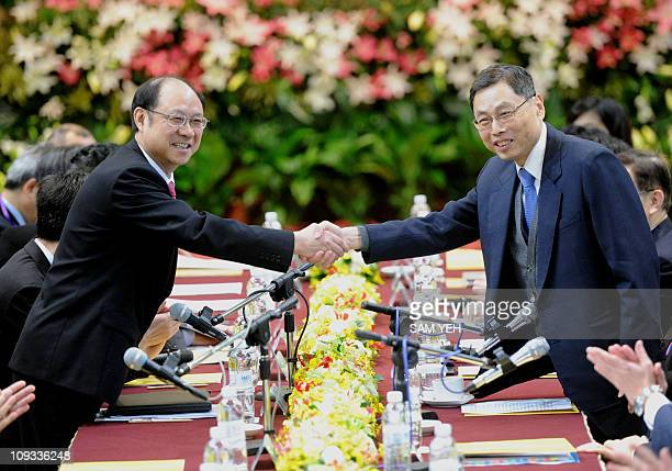 Kao Koonglian deputy chairman of Taiwan's Straits Exchange Foundation shakes hands with Zheng Lizhong vice president the mainland's Association for...