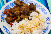 """Variation of """"Kao Krapaomoo"""" . Rice with tired munched pork and basil, pepper bell and apio. Thai food."""