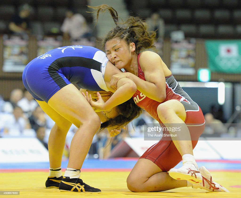Kaori Ichi (R) and <a gi-track='captionPersonalityLinkClicked' href=/galleries/search?phrase=Risako+Kawai&family=editorial&specificpeople=12551397 ng-click='$event.stopPropagation()'>Risako Kawai</a> compete during the Meiji Cup Invitational Cup Women's Freestyle 58kg final at Yoyogi National Gymnasium on June 15, 2014 in Tokyo, Japan.