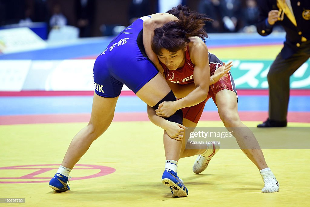 Kaori Icho (Red) and Risako Kawai (Blue) compete in Women's 58kg free style final match during 2014 Emperor's Cup All Japan Wresting Championship on December 23, 2014 in Tokyo, Japan.