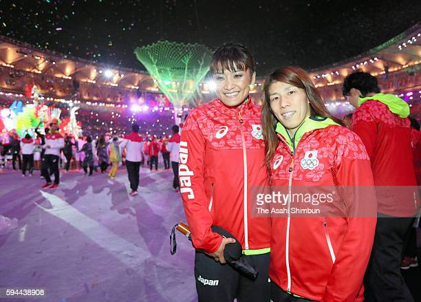 Kaori Icho and Saori Yoshida of Japan pose for photographs during the Closing Ceremony on Day 16 of the Rio 2016 Olympic Games at Maracana Stadium on...