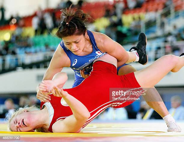 Kaori Icho of Japan and Anastasiya Huchok of Bulgaria compete in the Women's 58kg semi final match during day four of the FILA World Wrestling...