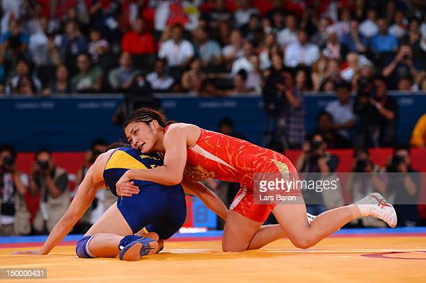 Kaori Icho of Japan and Ruixue Jing of China compete during the Women's Freestyle 63 kg Wrestling on Day 12 of the London 2012 Olympic Games at ExCeL...