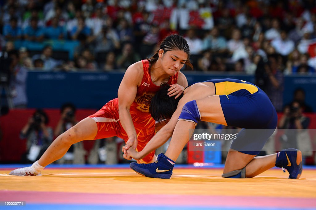 <a gi-track='captionPersonalityLinkClicked' href=/galleries/search?phrase=Kaori+Icho&family=editorial&specificpeople=2374687 ng-click='$event.stopPropagation()'>Kaori Icho</a> of Japan (red) and Ruixue Jing of China compete during the Women's Freestyle 63 kg Wrestling on Day 12 of the London 2012 Olympic Games at ExCeL on August 8, 2012 in London, England.