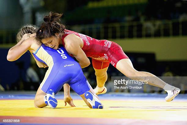 Kaori Icho of Japan and Valeria Koblova of Russia compete in the Women's 58kg gold medal match during day four of the FILA World Wrestling...