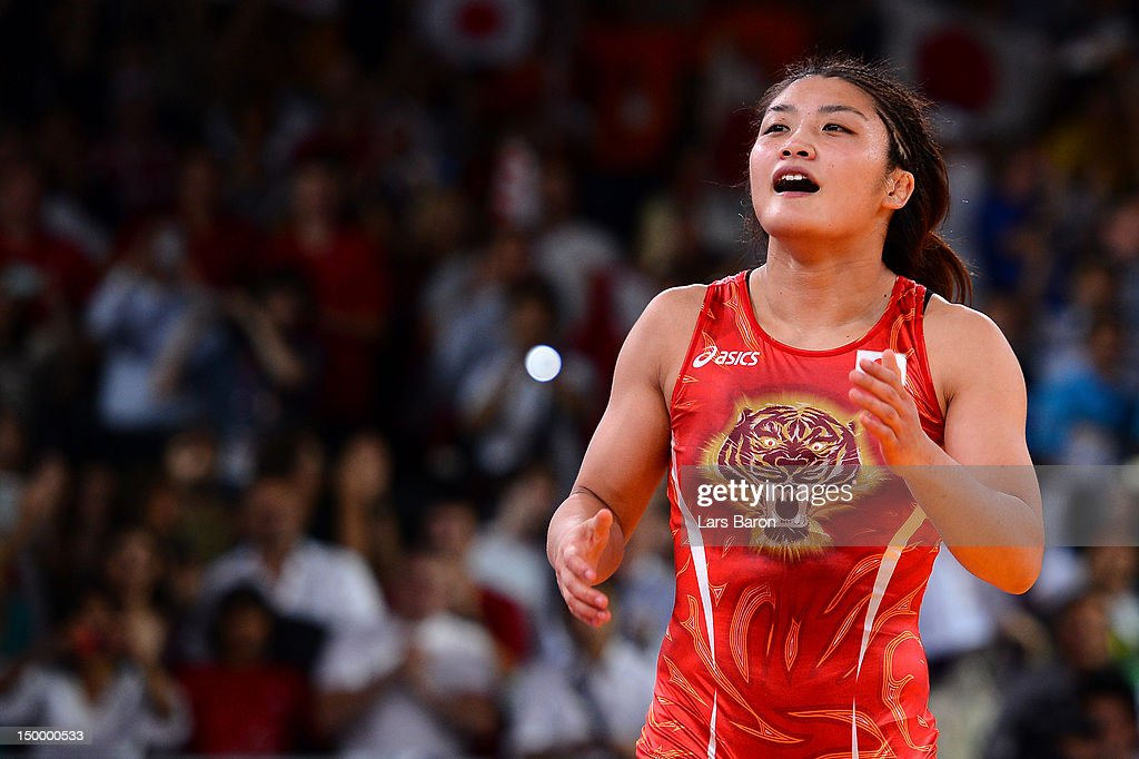 <a gi-track='captionPersonalityLinkClicked' href=/galleries/search?phrase=Kaori+Icho&family=editorial&specificpeople=2374687 ng-click='$event.stopPropagation()'>Kaori Icho</a> of Japan (red) celebrates defeating Ruixue Jing of China for the gold medal in the Women's Freestyle 63 kg Wrestling on Day 12 of the London 2012 Olympic Games at ExCeL on August 8, 2012 in London, England.