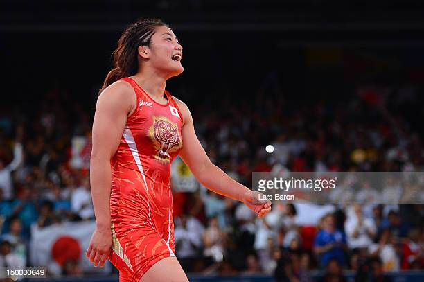 Kaori Icho of Japan celebrates defeating Ruixue Jing of China for the gold medal in the Women's Freestyle 63 kg Wrestling on Day 12 of the London...