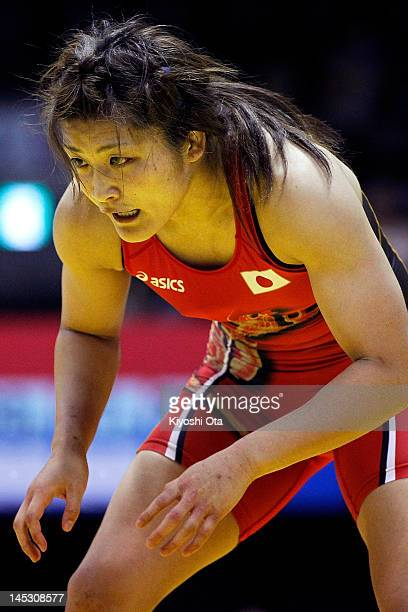 Kaori Icho of Japan competes against Jing Ruixue of China in the 63kg division of the third round match between Japan and China during day one of the...