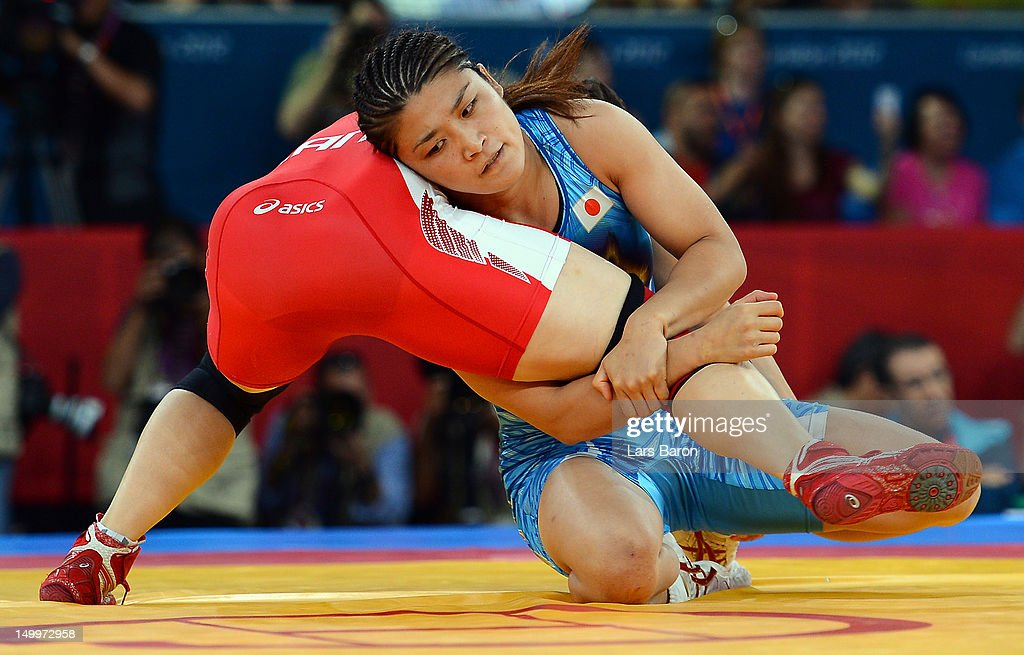 <a gi-track='captionPersonalityLinkClicked' href=/galleries/search?phrase=Kaori+Icho&family=editorial&specificpeople=2374687 ng-click='$event.stopPropagation()'>Kaori Icho</a> of Japan (blue) competes against <a gi-track='captionPersonalityLinkClicked' href=/galleries/search?phrase=Martine+Dugrenier&family=editorial&specificpeople=4511853 ng-click='$event.stopPropagation()'>Martine Dugrenier</a> of Canada (red) in the Women's Freestyle 63 kg Wrestling on Day 12 of the London 2012 Olympic Games at ExCeL on August 8, 2012 in London, England.
